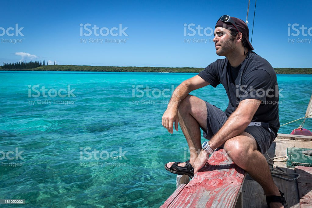 Man on Dugout Canoe, Isle of Pines, New caledonia royalty-free stock photo