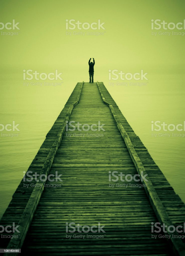 Man on End of Dock, Toned stock photo