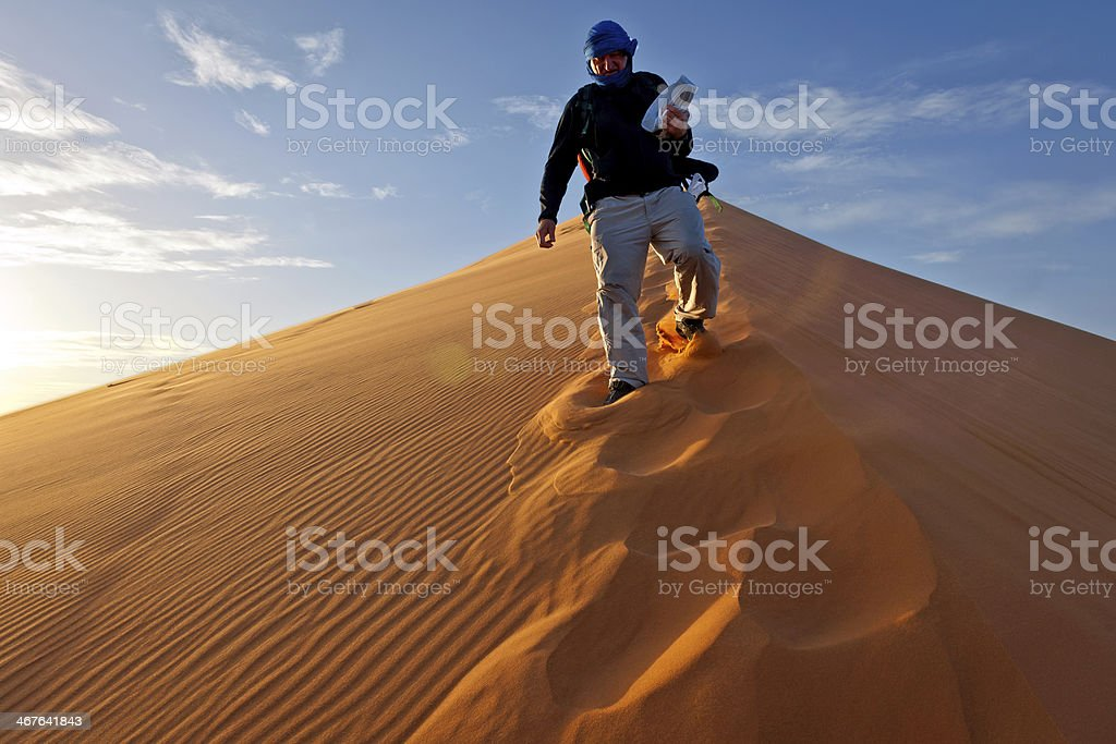 Man on Erg Chebbi Sand Dune at Sunrise, Morocco, Africa stock photo