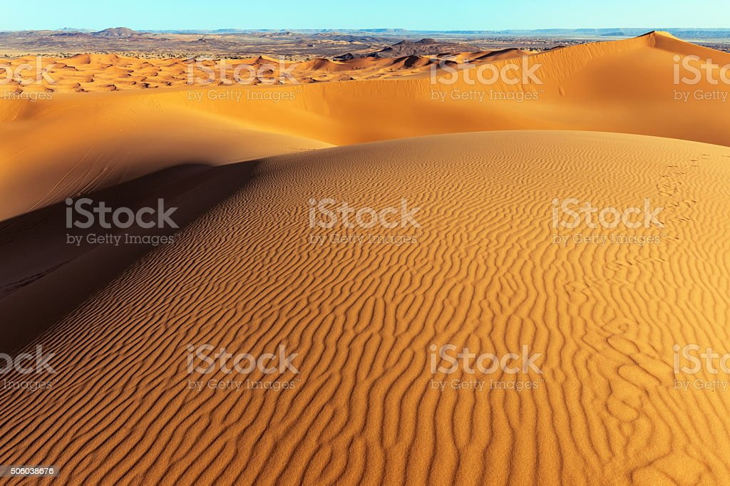 Man on Erg Chebbi Sand Dune at Sunrise, Morocco, Africa stock photo
