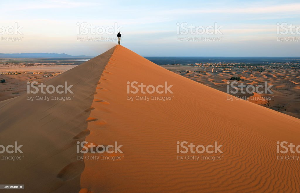 Man on Erg Chebbi Sand Dunes at Sunrise, Morocco, Africa stock photo