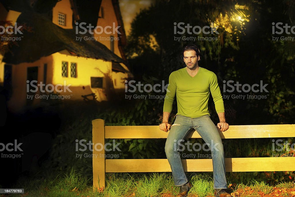 Man on fence royalty-free stock photo