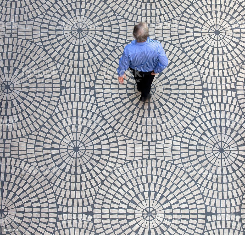 Man on geometric tiles stock photo