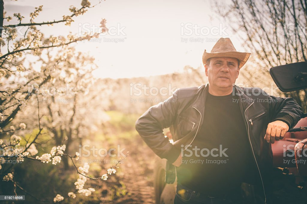 Man on his orchard stock photo