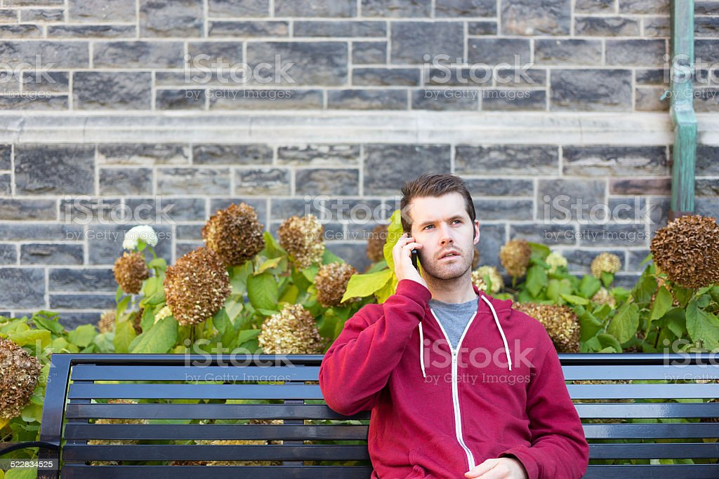Man on his phone looking worried stock photo