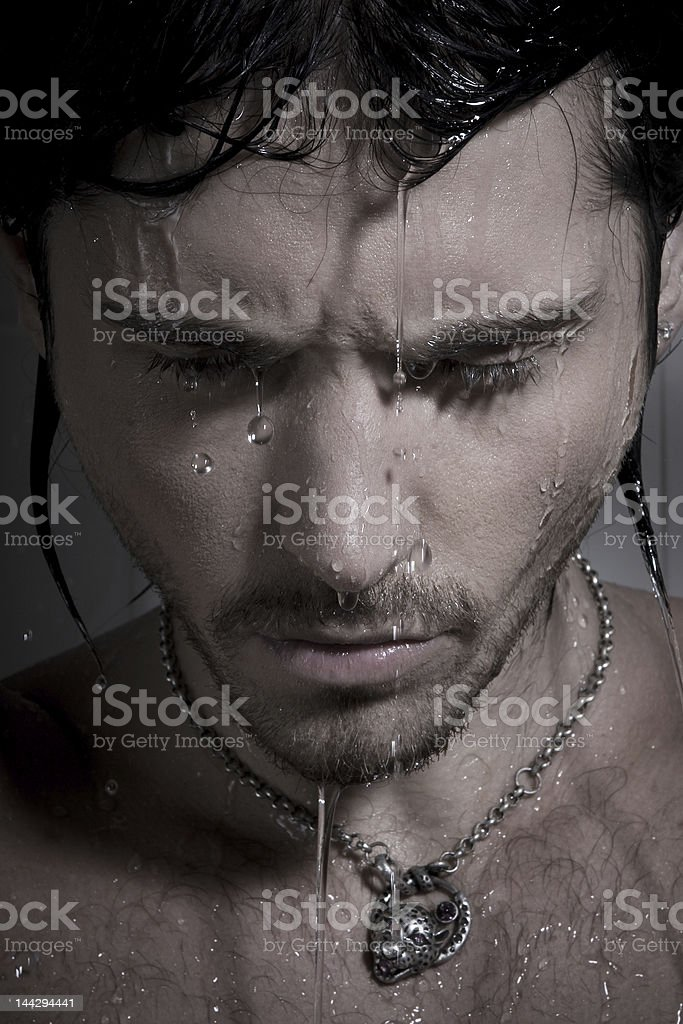 man on jets of water stock photo