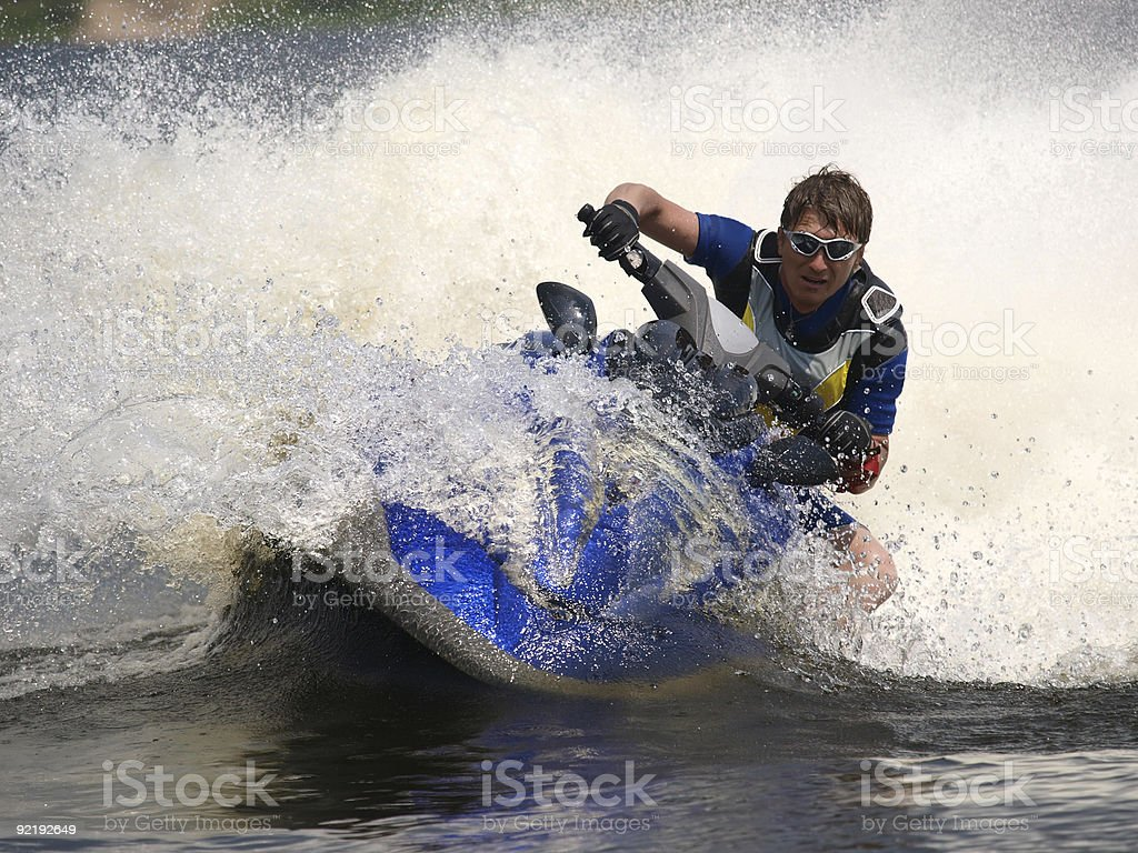 Man on jet-ski turns very fast with diving royalty-free stock photo