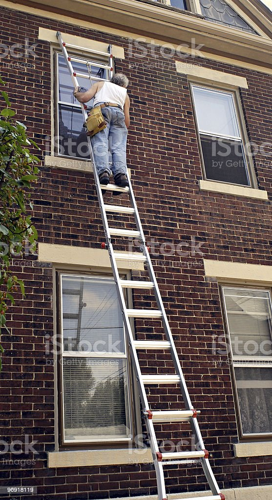 Man on Ladder royalty-free stock photo