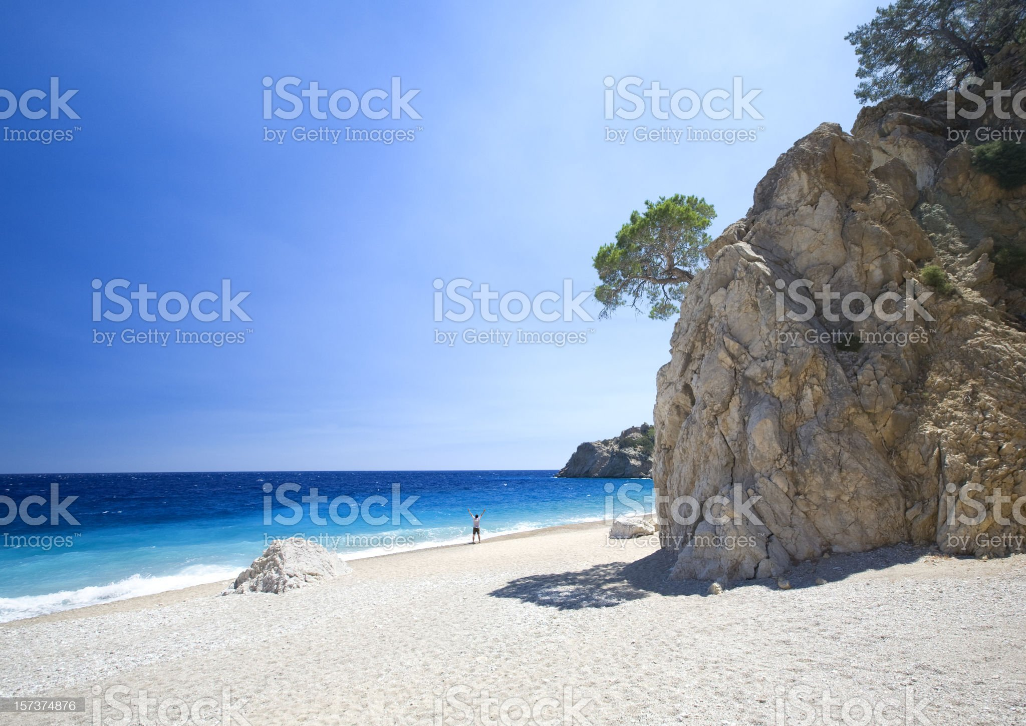 Man on lonely beach royalty-free stock photo