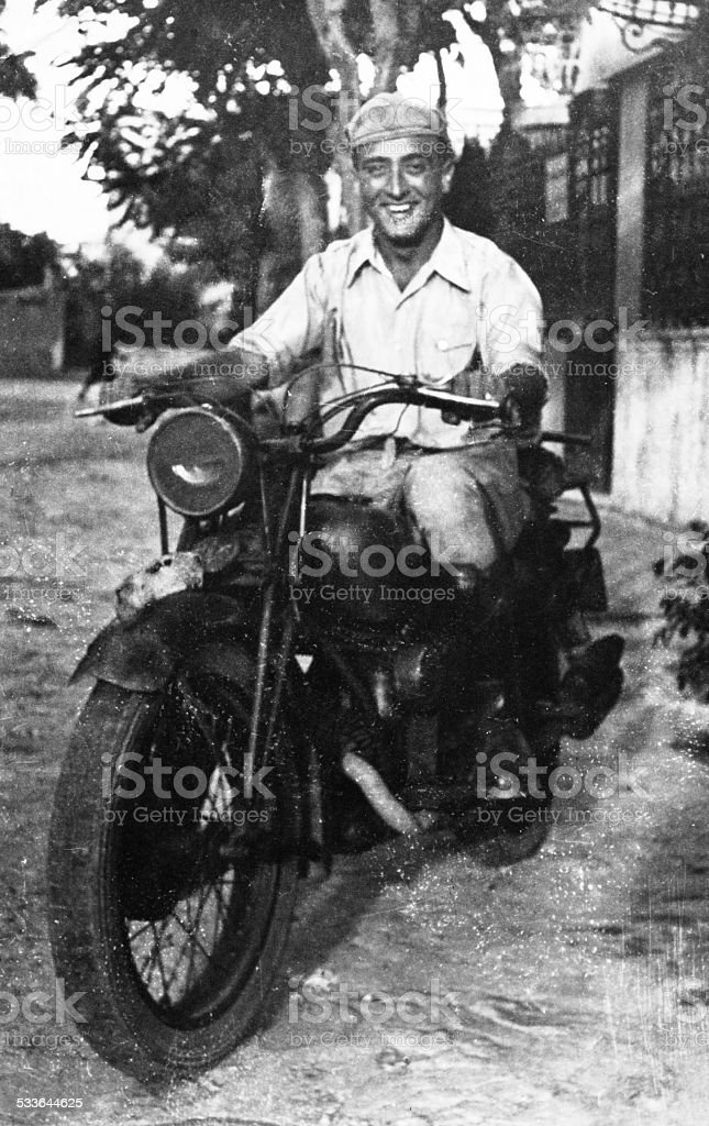 Man on motorbike in 1945 stock photo