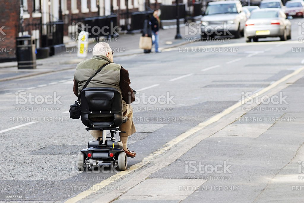 Man on motorized chair in the streets of Liverpool stock photo