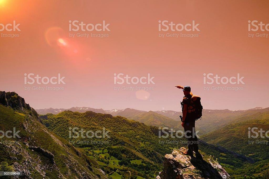 Man on mountain at dawn. stock photo