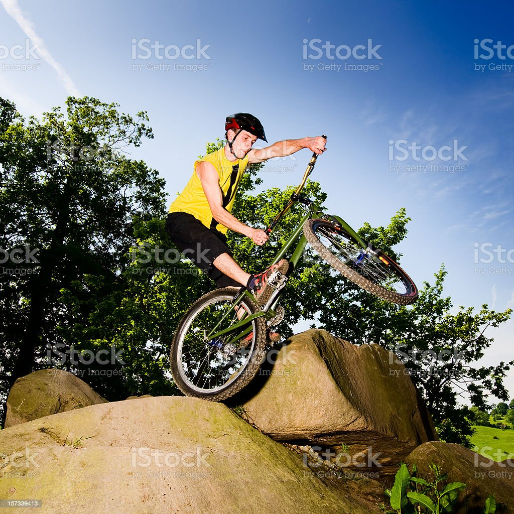 Man on mountain bike jumping off rock royalty-free stock photo