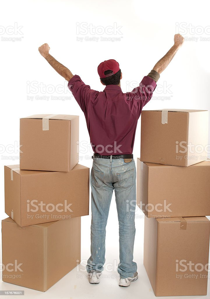Man on moving, house full of package - final success royalty-free stock photo