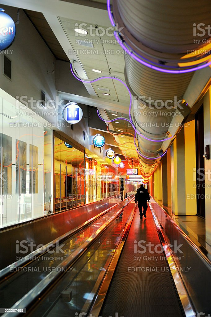 Man on Moving Walkway at Philadelphia Airport stock photo