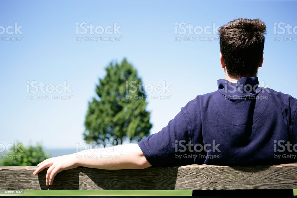 XXL man on park bench royalty-free stock photo