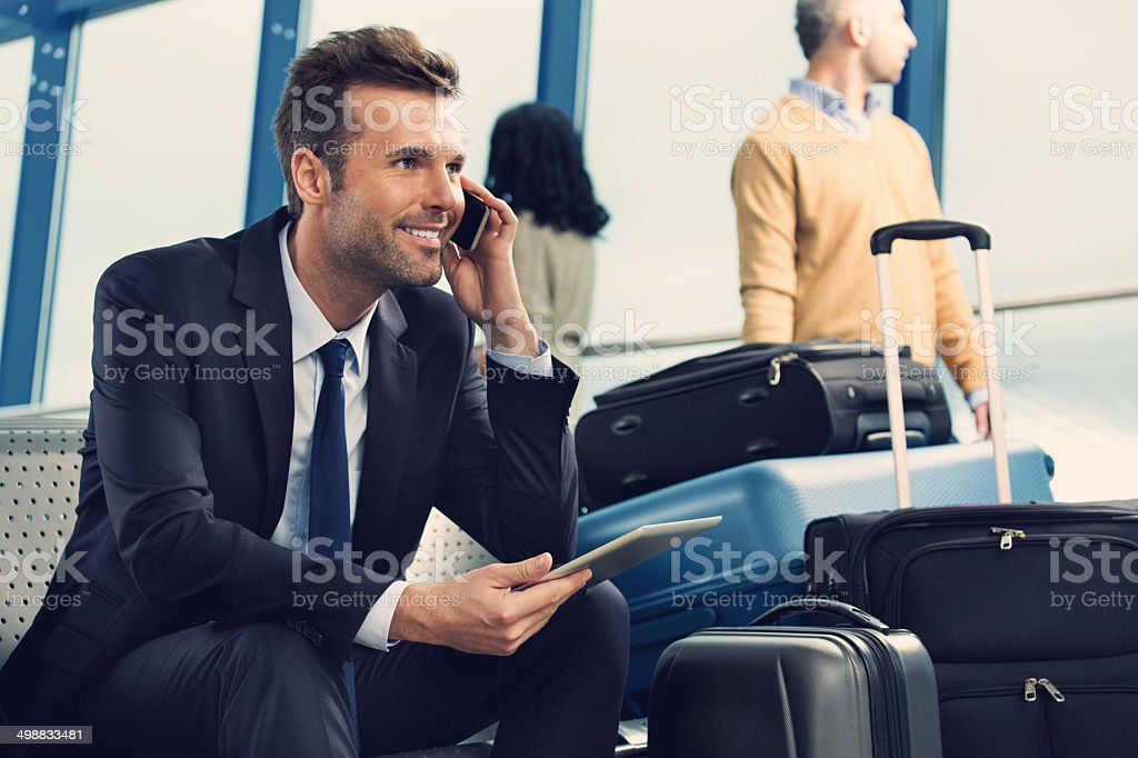 Man on phone at the airport stock photo