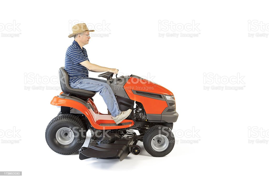 Man on Riding Lawn Mower stock photo
