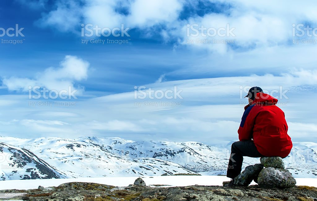 Man on rock stock photo