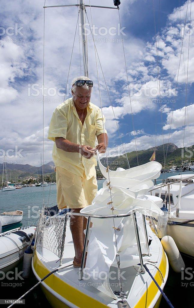 Man on Sailboat royalty-free stock photo