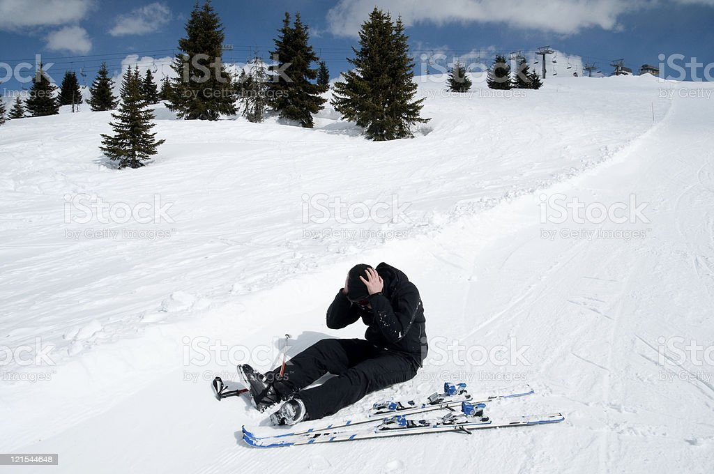 Man on skiing vacation has a head injury on slope stock photo