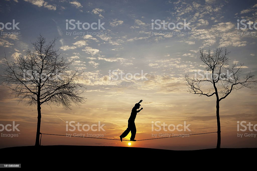 man on slackline in sunset stock photo