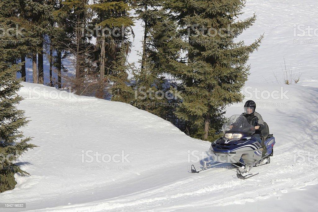 Man on snowmobile royalty-free stock photo