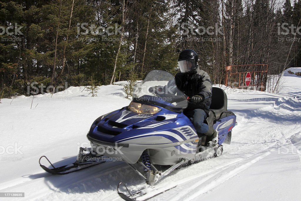 Man on snowmobile royalty-free stock photo