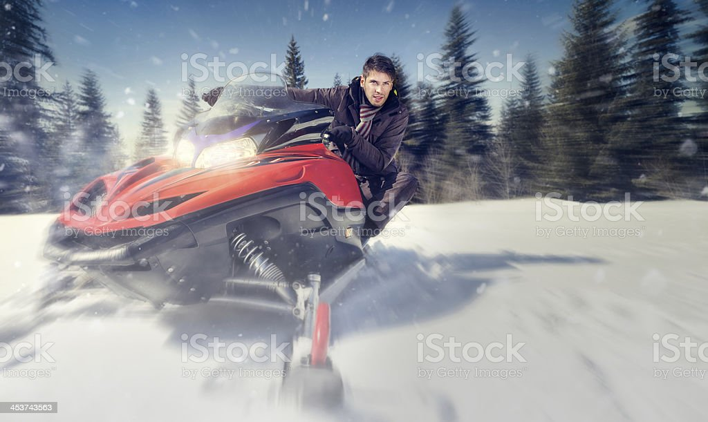 man on snowmobile stock photo