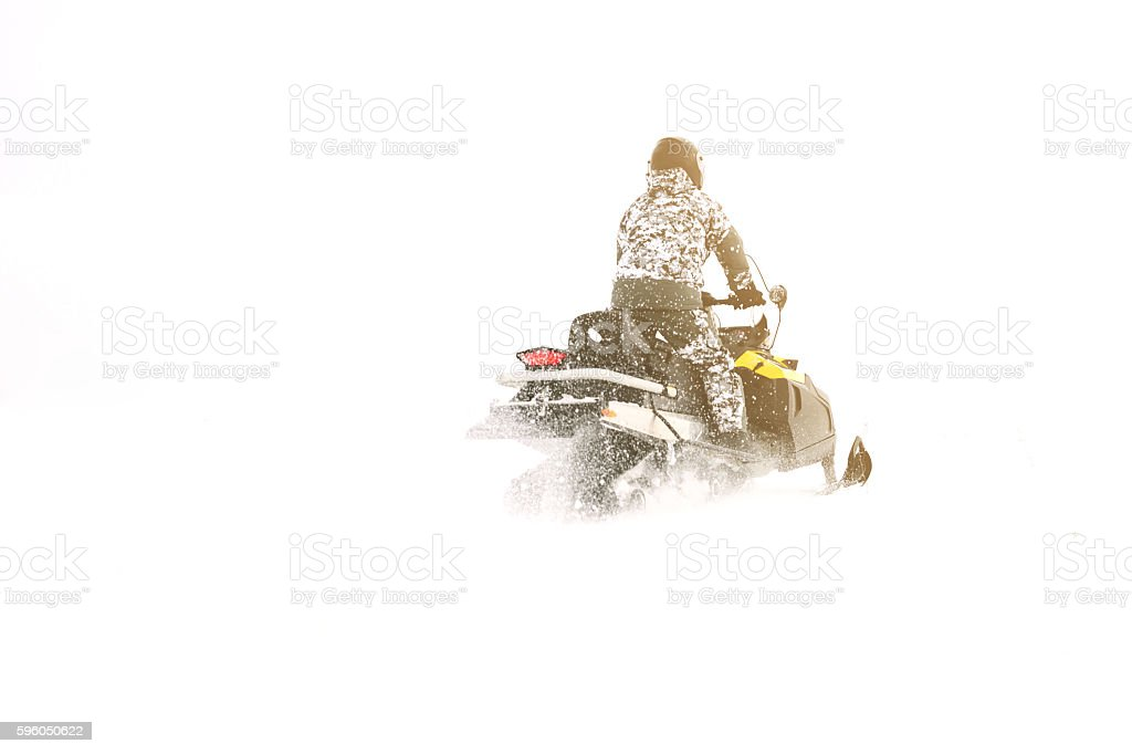 Man on snowmobile. Winter sports. stock photo