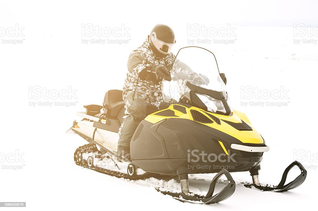 Man on snowmobile. Recreation concept on nature in winter holidays....