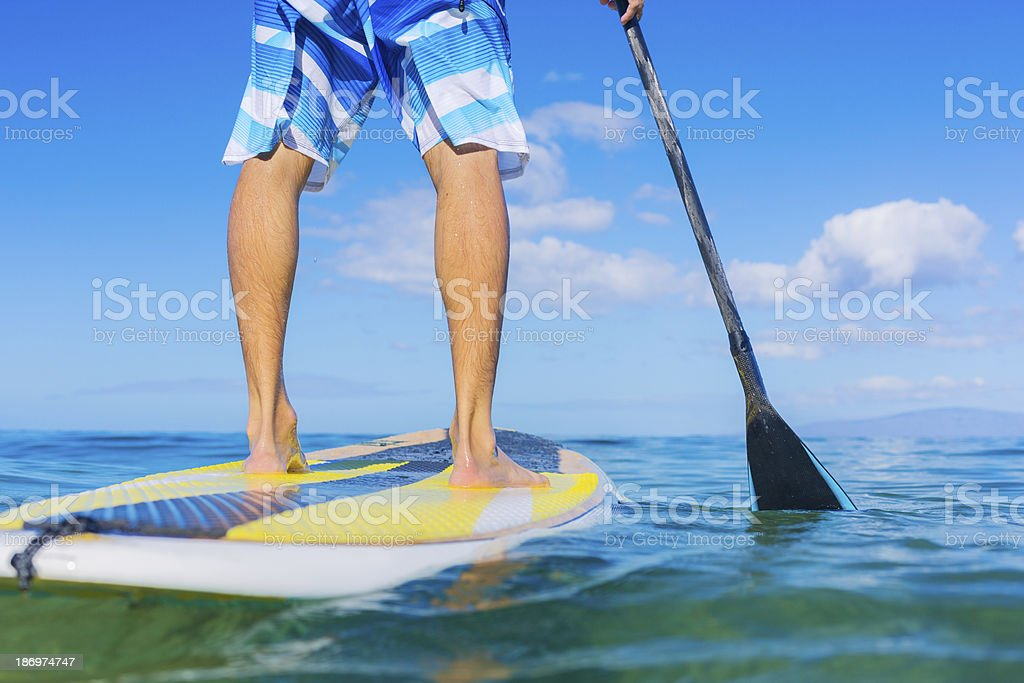 Man on stand up paddle board in Hawaii stock photo