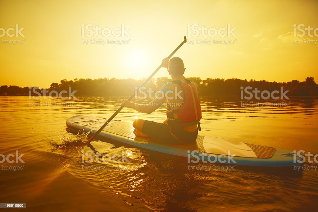 Man on Stand Up Paddle Board stock photo