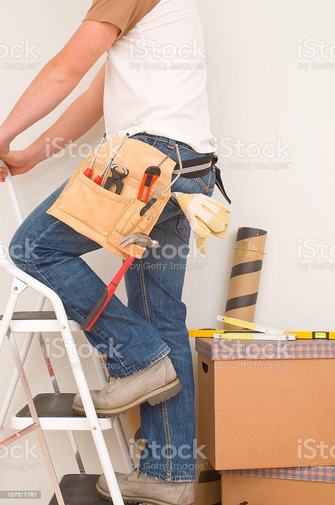 Man on step ladder royalty-free stock photo