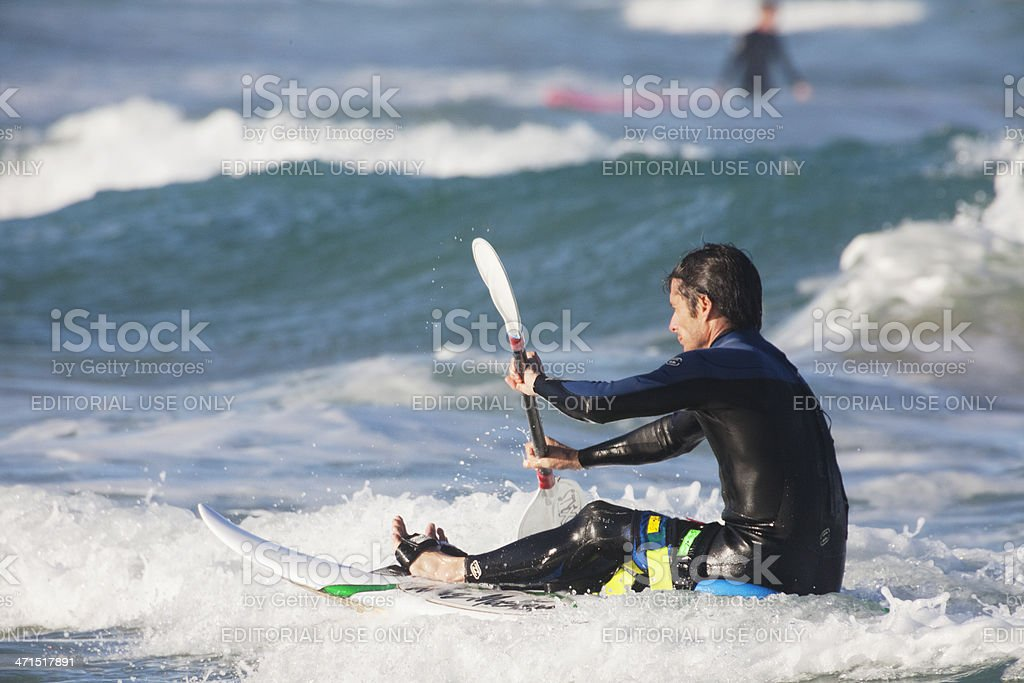 Man on surfing kayak royalty-free stock photo