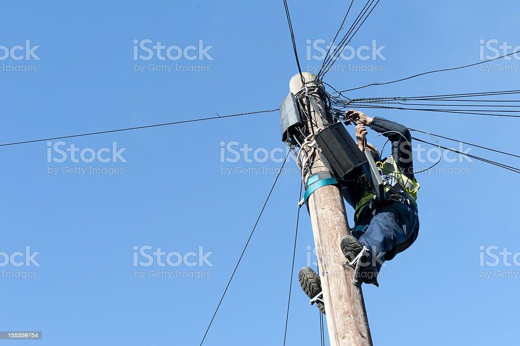 Man on Telegraph Pole stock photo