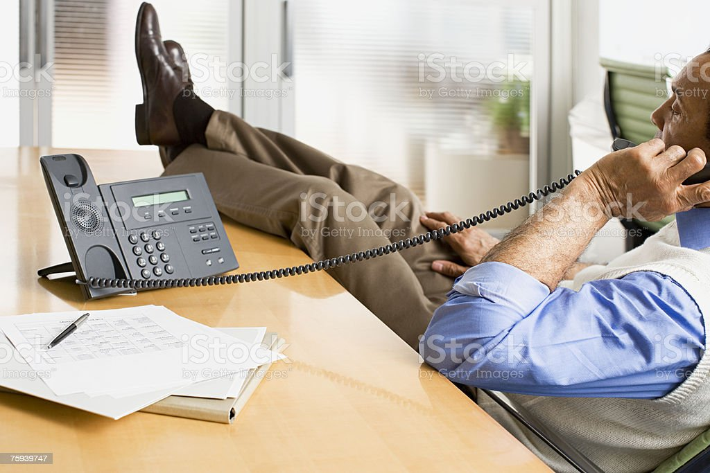 Man on telephone in office royalty-free stock photo