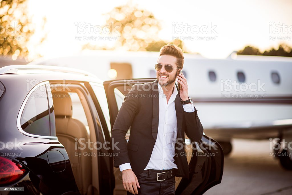 Man on the airport with phone in his hand stock photo