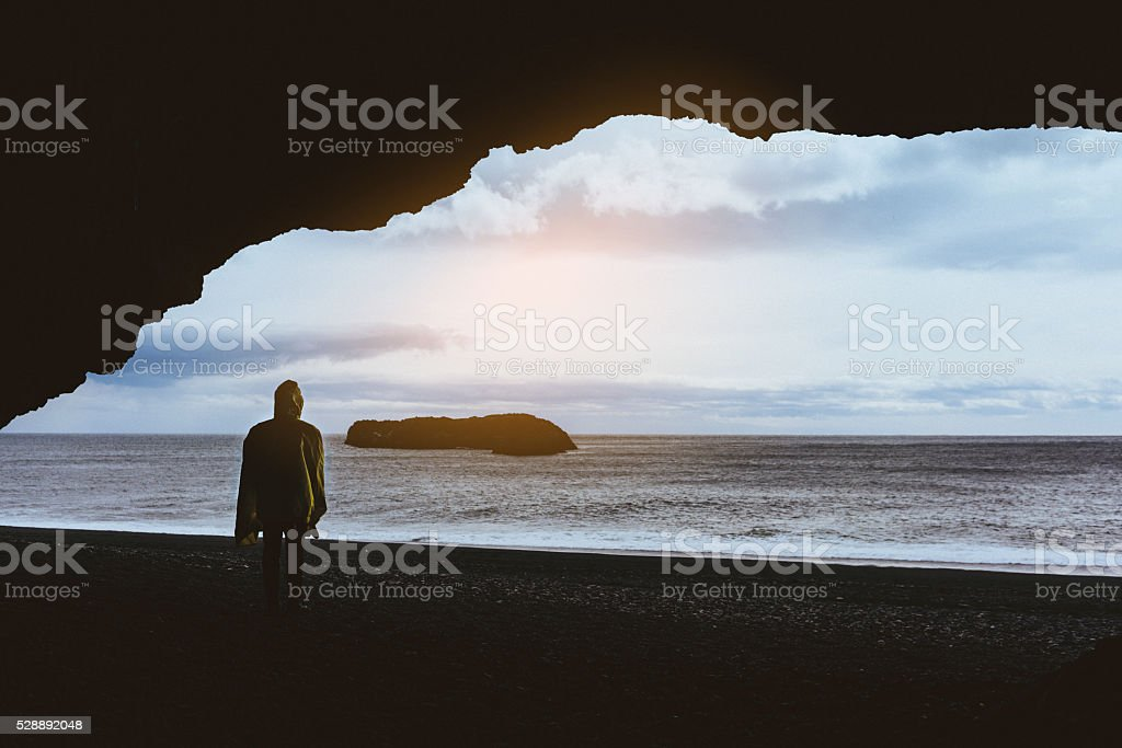 Man on the back sand beach stock photo