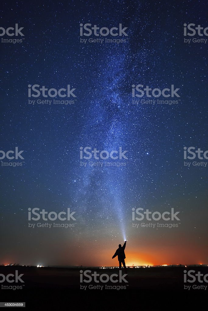 man on the background of bright stars  night sky. royalty-free stock photo