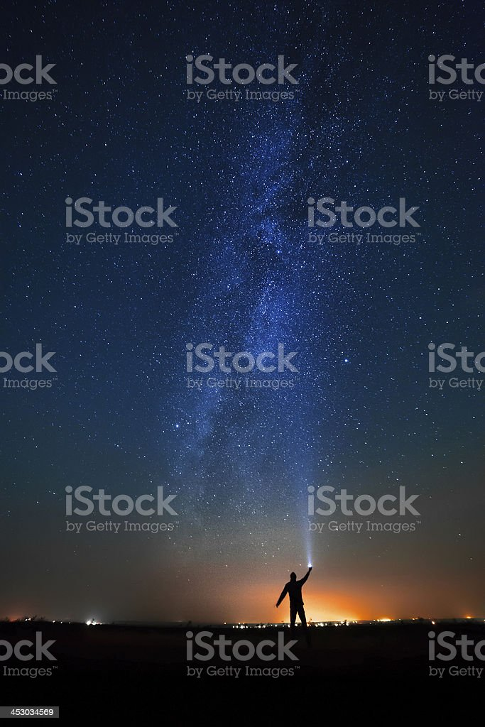 man on the background of bright stars  night sky. stock photo