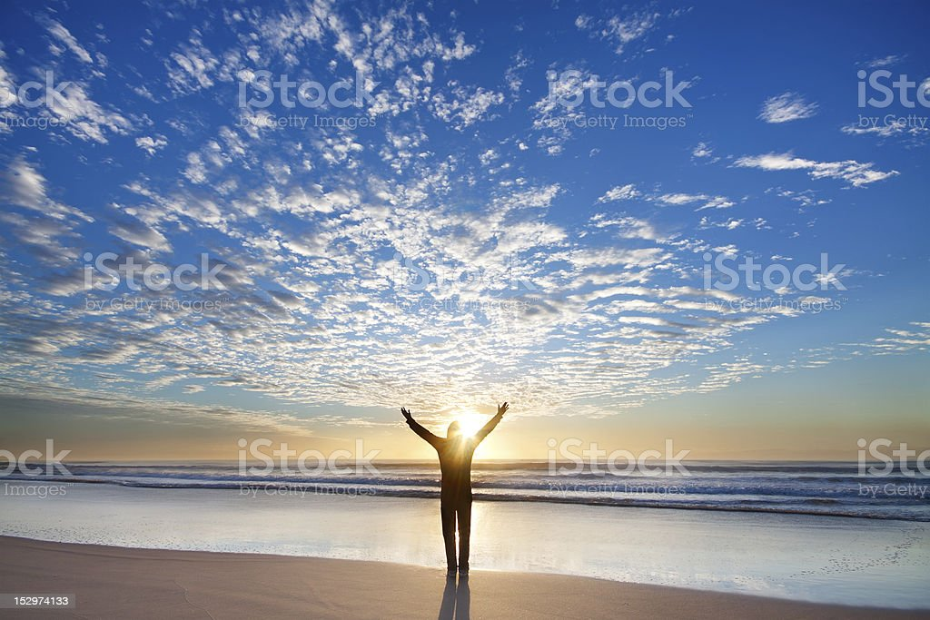 Man on the beach appreciate beautiful sunrise royalty-free stock photo