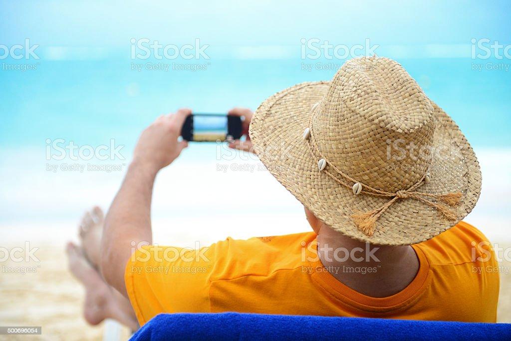man on the beach stock photo