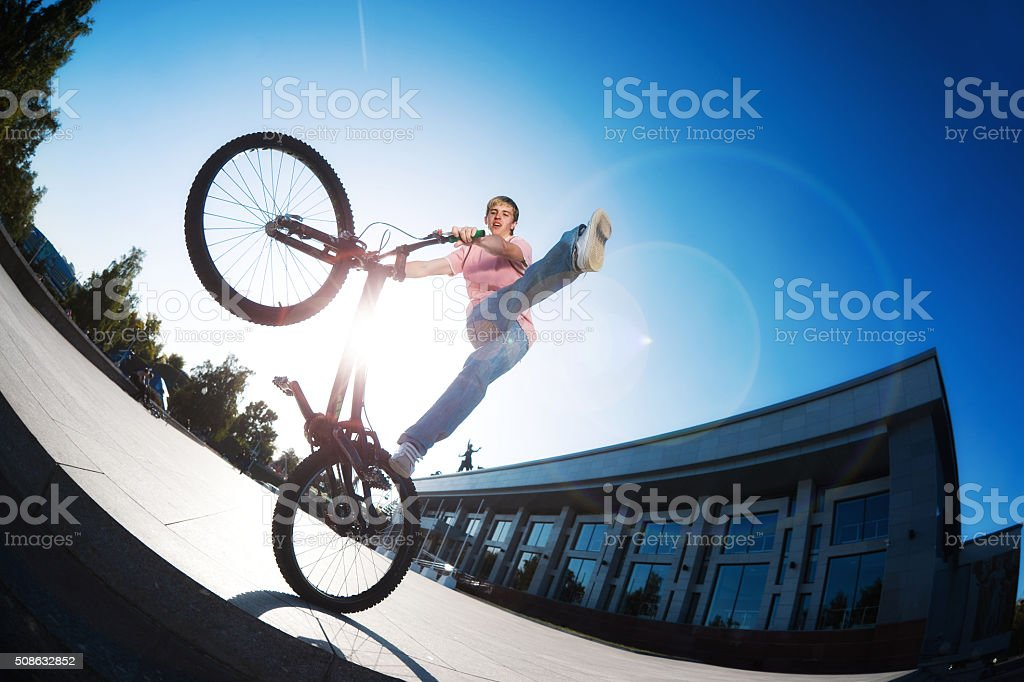 man on the bicycle doing stunt stock photo