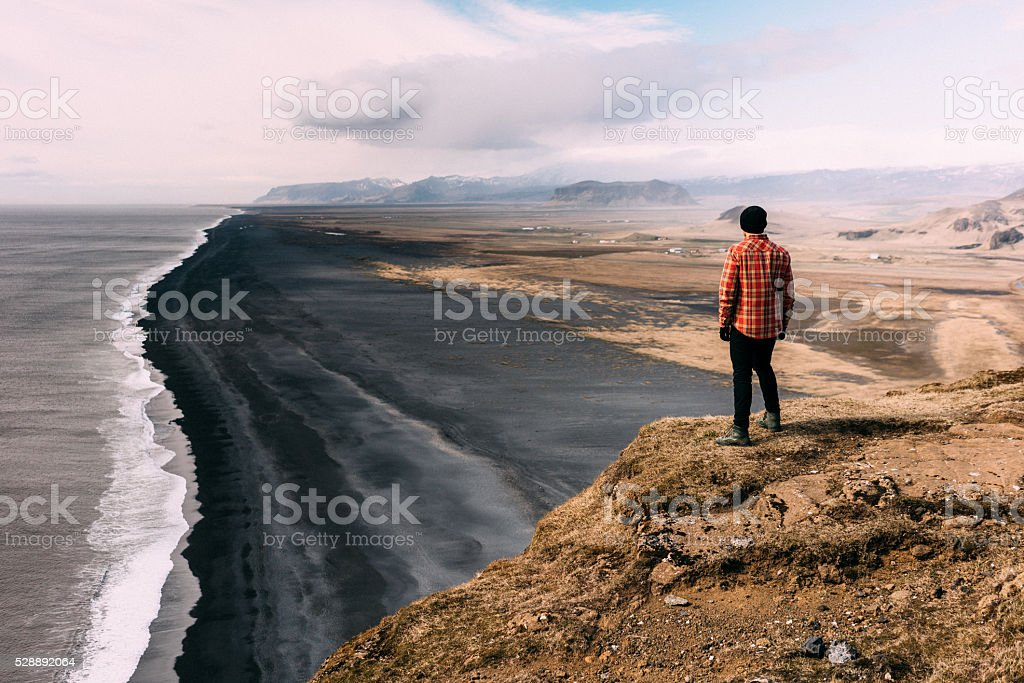 Man on the cliff stock photo