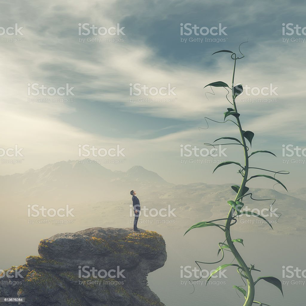 Man on the edge of a cliff stock photo