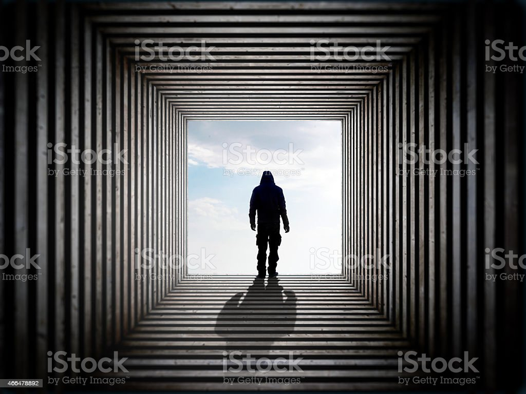 Man on the edge of the tunnel stock photo