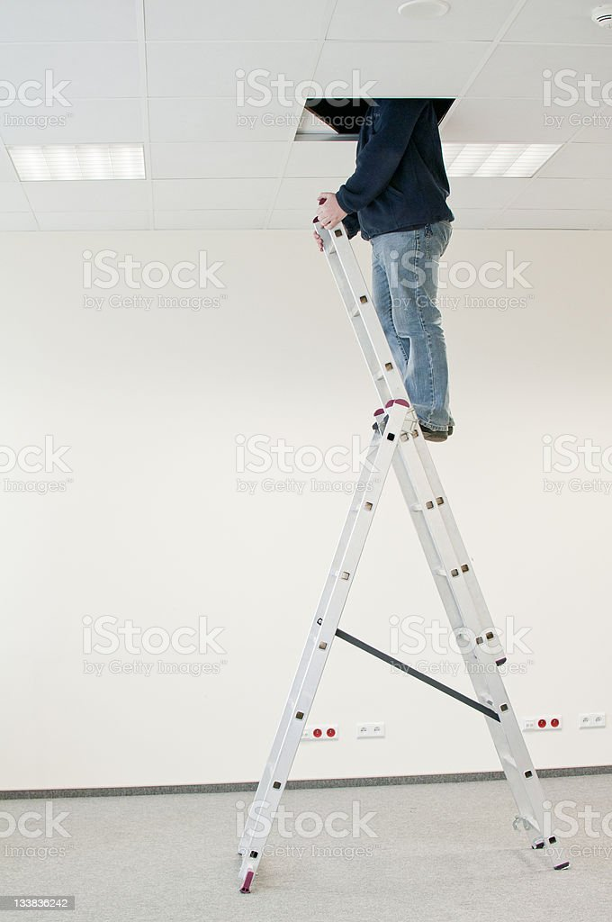 man on the ladder royalty-free stock photo