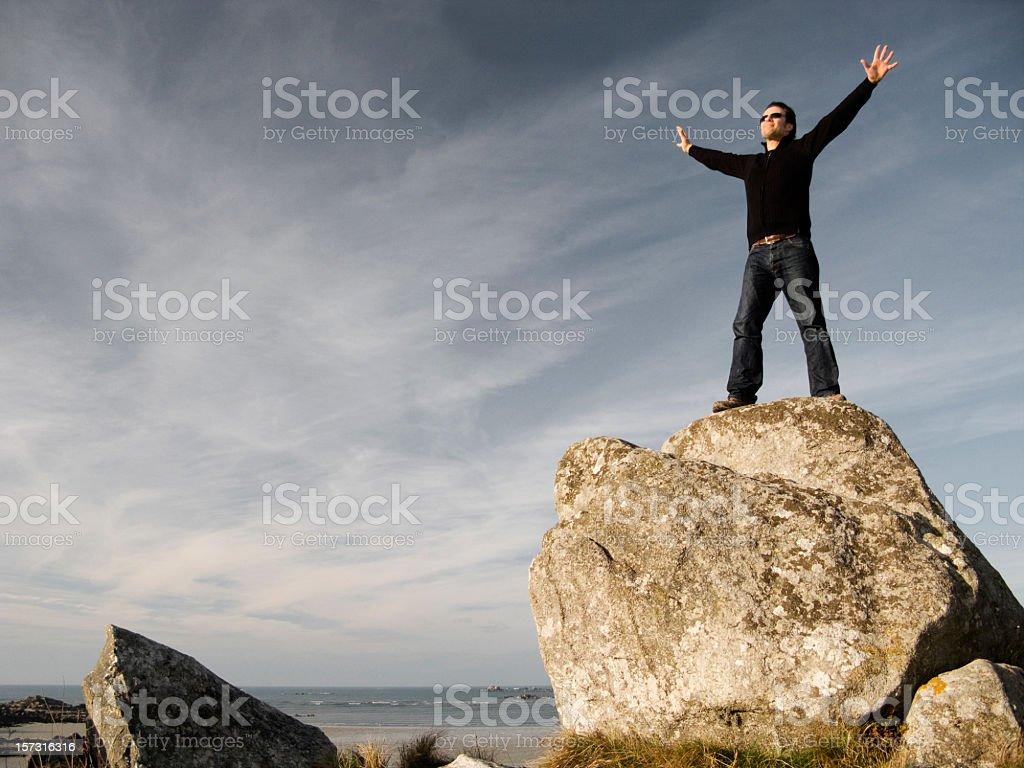 man on the rock stock photo