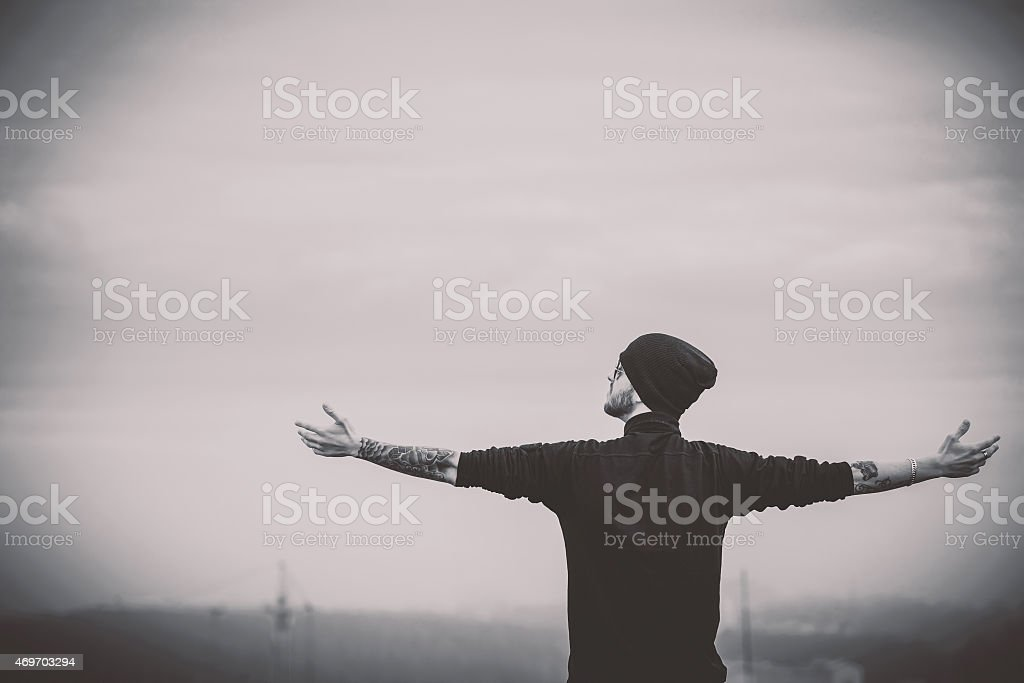 Man on the roof of the high building stock photo